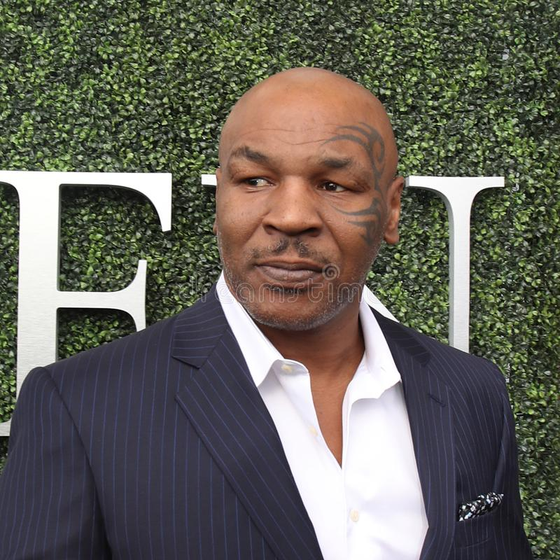 Former boxing champion Mike Tyson attends US Open 2017 opening ceremony. NEW YORK - AUGUST 28, 2017: Former boxing champion Mike Tyson attends US Open 2017 royalty free stock photo
