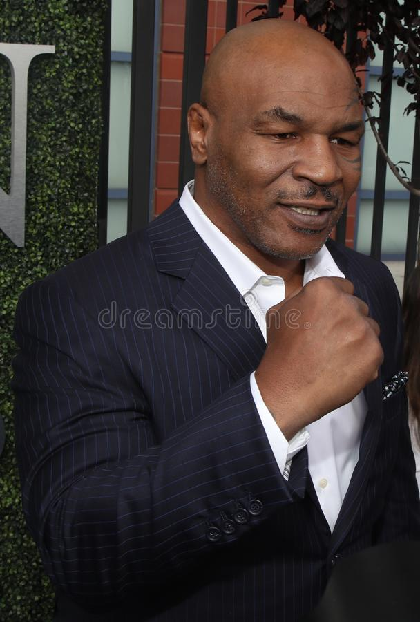 Former boxing champion Mike Tyson attends US Open 2017 opening ceremony. NEW YORK - AUGUST 28, 2017: Former boxing champion Mike Tyson attends US Open 2017 stock photo