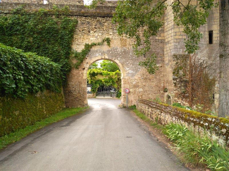 Corridor XVI century. Former bridge lamp Road path Stone hole greenery green Window rempart door royalty free stock photo