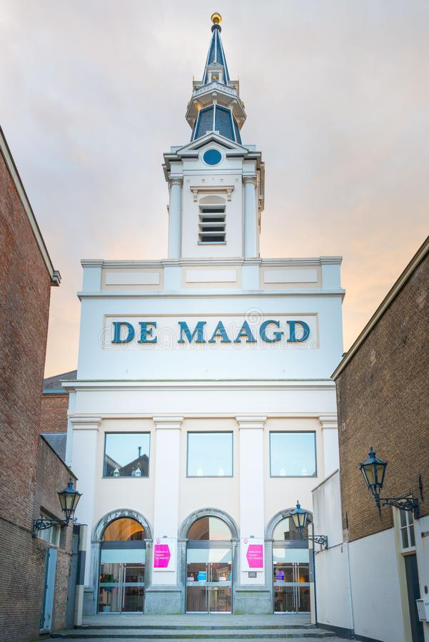 Former church De Maagd, currently theater, Bergen op Zoom. Former church De Maagd, currently theater, at main square Bergen op Zoom, the Netherlands royalty free stock photos