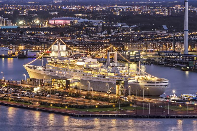 Former cruis ship at night. Rotterdam, the Netherlands, February 2, 2018: Brightly illuminated former cruiseship SS Rotterdam, now a hotel and congress center stock images