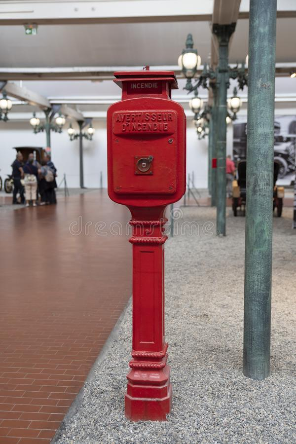 Ancient French fire alarm with written on it: `fire` and `fire alarm`. Former fire alarm in France stock photo