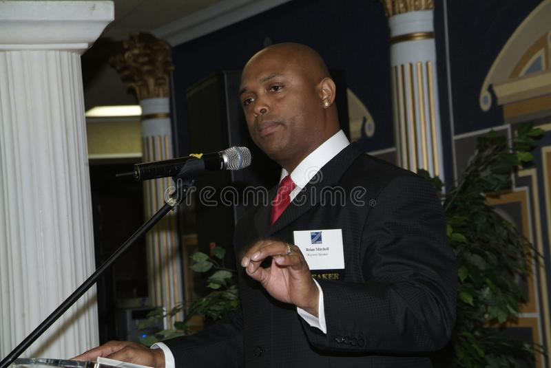 Former NFL football star as a keynote speaker. Former NFL Football star formerly with Redskins and Giants and TV personality Brian Mitchell was the lkeynote royalty free stock photography