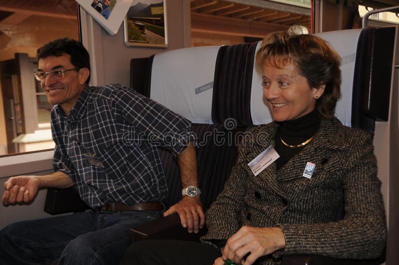 Former Swiss Chancellor and Minister of Justice Eveline Widmer-Schlumpf with her husband in the Rhb-train to St. Moritz. For the 100 years of RhB celebration royalty free stock image