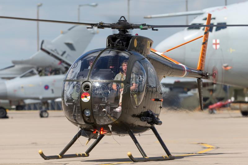 Former United States Army Hughes OH-6A Cayuse 69-16011 military helicopter G-OHGA. RAF Waddington, Lincolnshire, UK - July 7, 2014: Former United States Army royalty free stock image