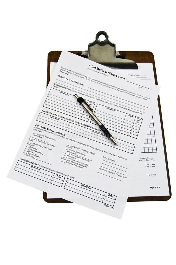 Formes d'antécédents médicaux sur une planchette image libre de droits