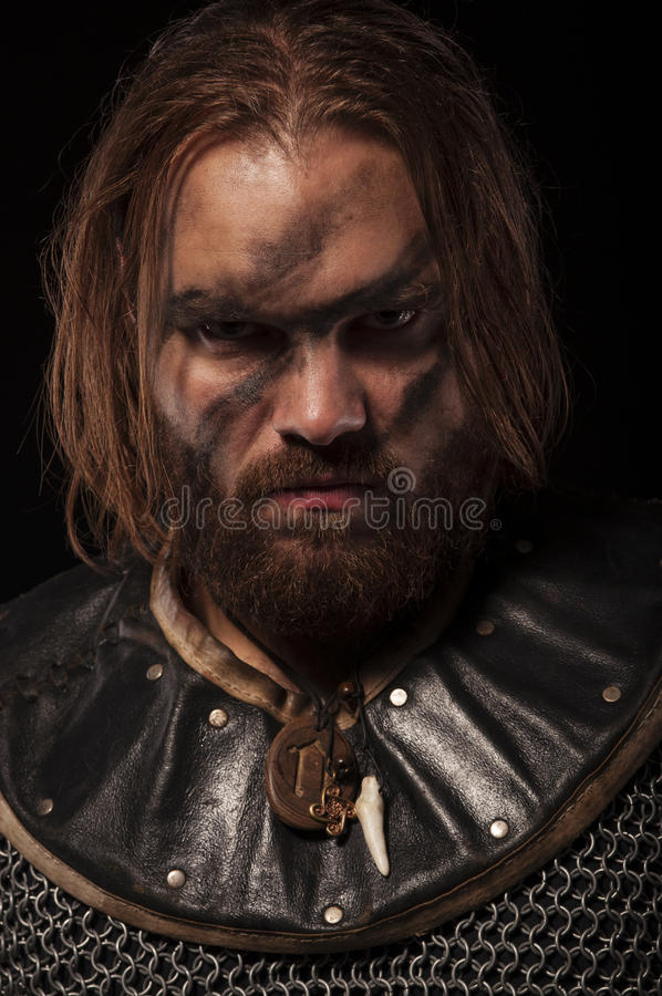 Formidable viking in chain armor over black background royalty free stock photos