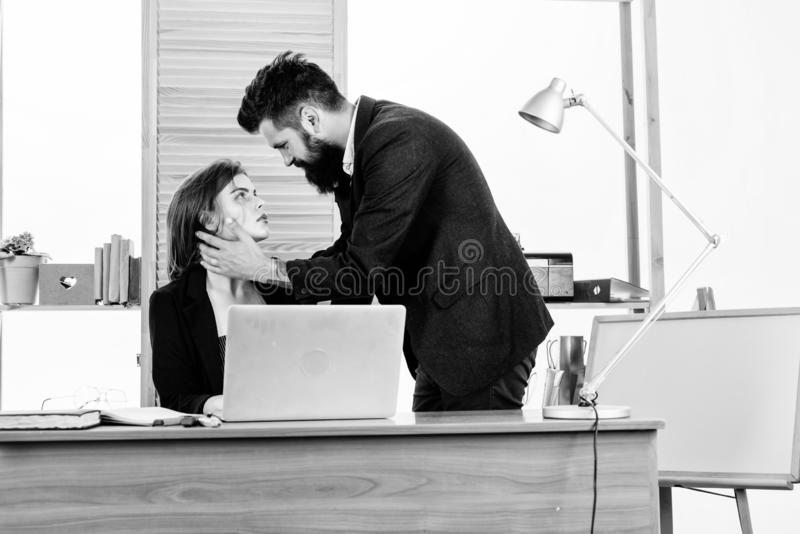 Forming close bonds with workmate. Workplace affair. Boss and secretary having sweet affair. Love affair of bearded man royalty free stock image