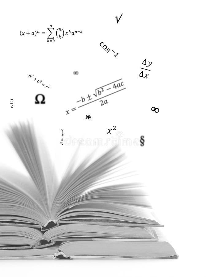 Formler och bok arkivbild