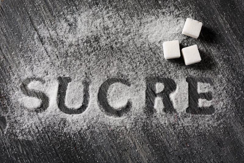 Formułuje cukier w Francuskim lub katalończyku pisać z cukierem obraz stock
