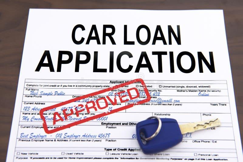 Formulário de candidatura aprovado do empréstimo automóvel fotos de stock