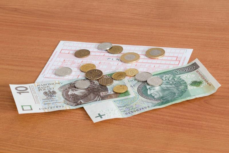 Formulário de imposto do pagamento com inscrição do podatki e dinheiro do polimento foto de stock royalty free