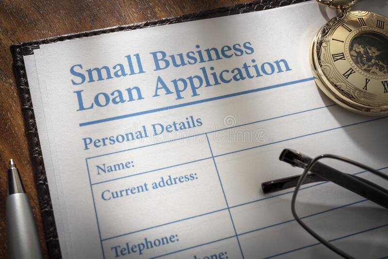 Formulário de pedido de empréstimo para pequenas empresas fotografia de stock