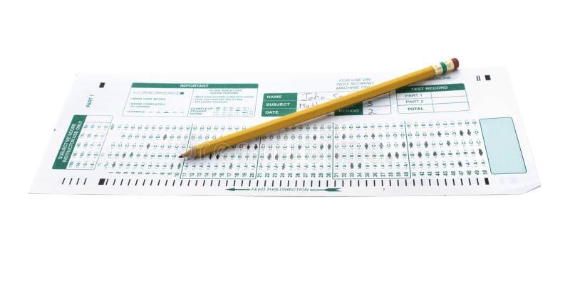 Formulário do exame com um lápis da escola foto de stock