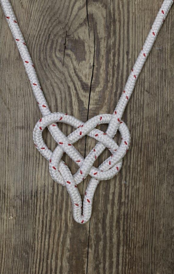 Formulário marinho do nó da corda de um coração fotos de stock royalty free