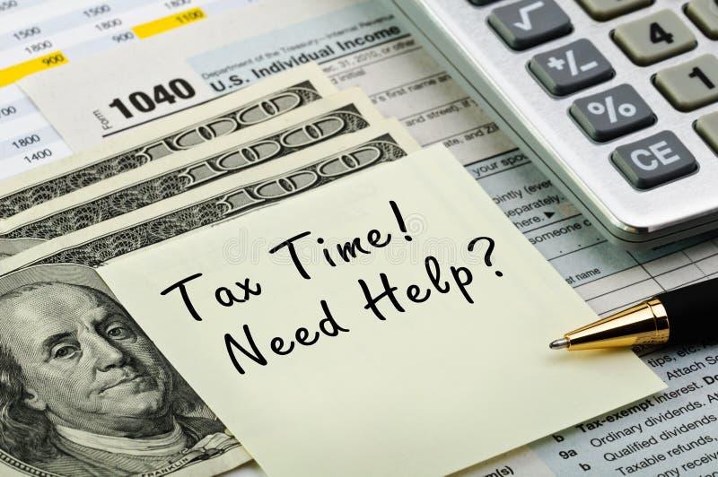 Formulários de imposto com pena, calculadora e dinheiro. imagens de stock royalty free
