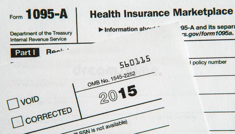 Formulários de imposto para o ato disponível dos cuidados médicos foto de stock