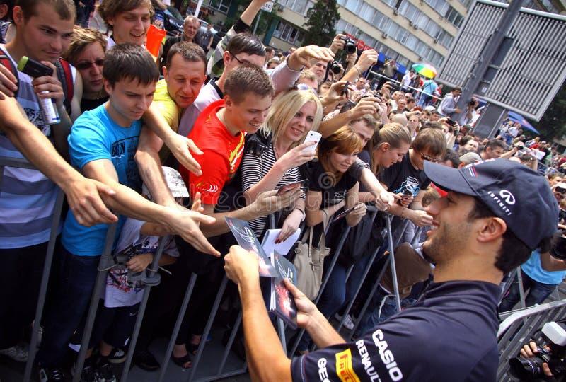 Formula 1 driver Daniel Ricciardo of Red Bull Racing Team. KYIV, UKRAINE - MAY 19, 2012: Formula 1 driver Daniel Ricciardo of Red Bull Racing Team signs stock images