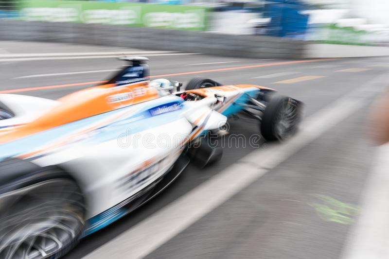 Formula E racing car on race track. Berlin, Germany - May 21, 2016: Formula E racing car on race track. The FIA Formula E Championship is a class of auto racing royalty free stock image