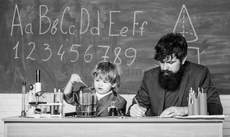 Formula. experiments in organic chemistry laboratory. small boy with teacher man. Wisdom. Back to school. son and father stock image
