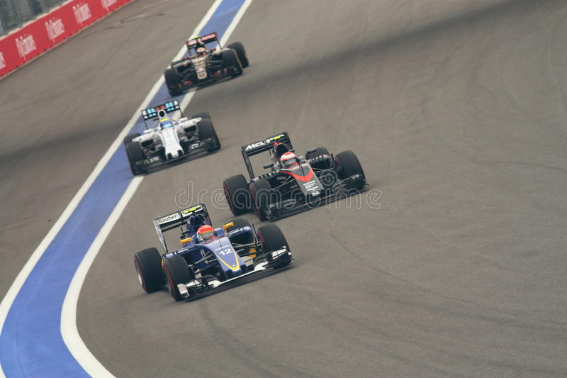 FORMULA 1 Grand Prix 2015. Jenson Button of McLaren Honda F1 Team overtaking is very close and dangerous of Felipe Nasr of Sauber F1 Team in Sochi on October royalty free stock images