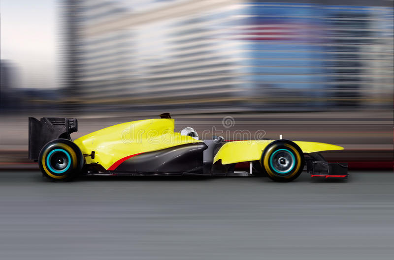 Formula one car driving. At high speed on empty road - motion blur royalty free stock photo