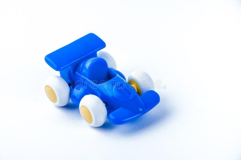 Formula one car toy. Blue formula one car toy royalty free stock photography