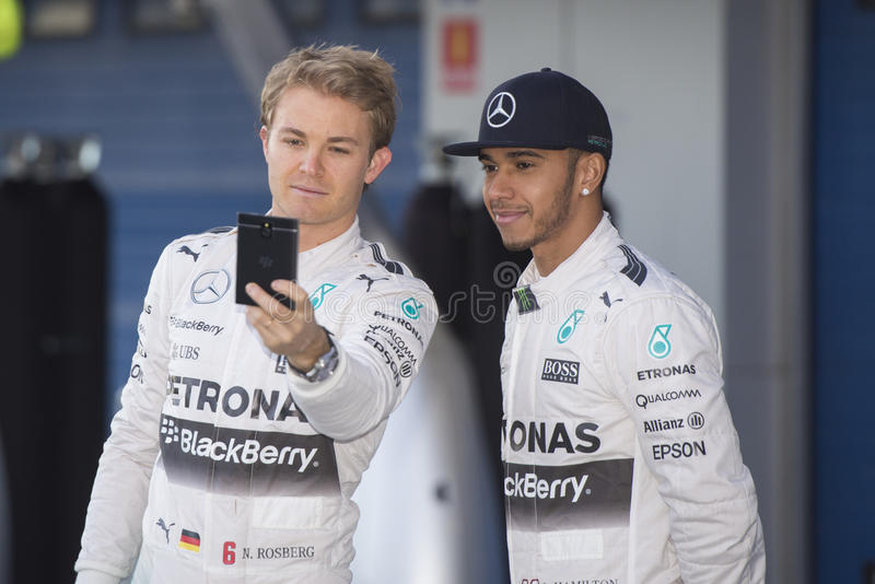 Formula 1, 2015: Selfie of Nico Rosberg and Lewis Hamilton royalty free stock photography