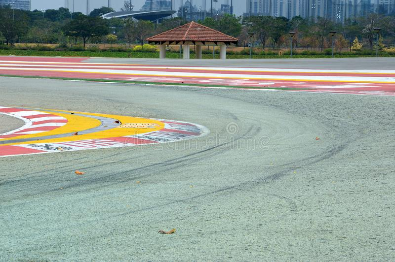 Formula 1 track curve in Singapore. One of the many curves in the Singapore Formula 1 track. Winter time and fallen leaves on the track. Pre-season. Singapore royalty free stock photos