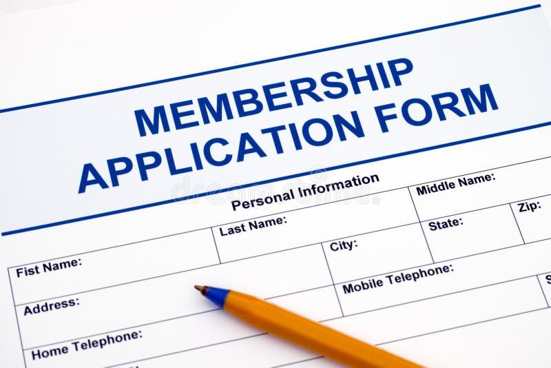Formulaire de demande d'adhésion avec le stylo photographie stock