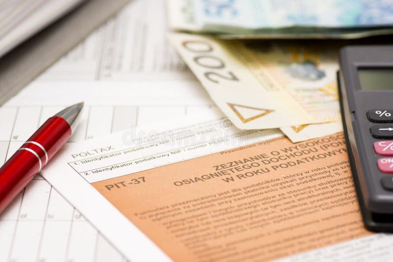 Formularios de impuesto polacos de relleno imágenes de archivo libres de regalías