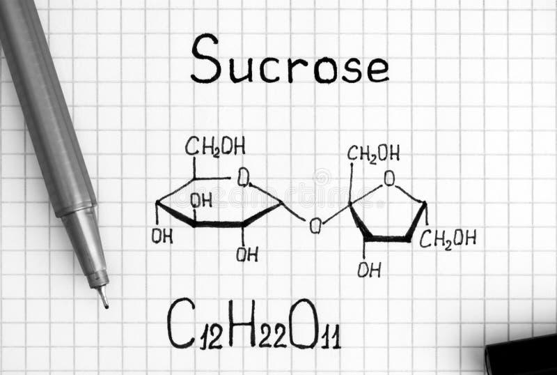 Formule chimique de sucrose avec le stylo noir photo stock