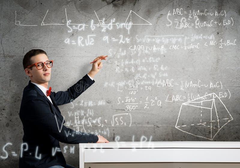 Formule di scienza del disegno dello studente immagine stock