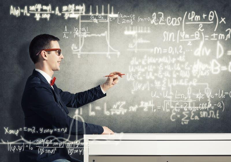 Formule di scienza del disegno dello studente immagine stock libera da diritti