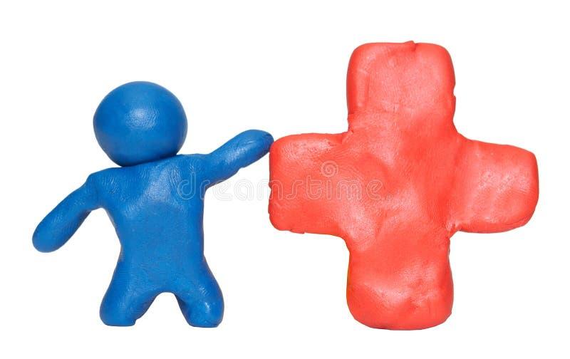 Formung des Lehmmannes mit rotem Kreuz lizenzfreies stockfoto