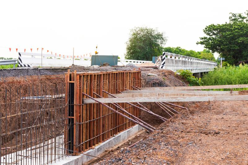 Formwork for the concrete to prevent water erosion along the road stock photos
