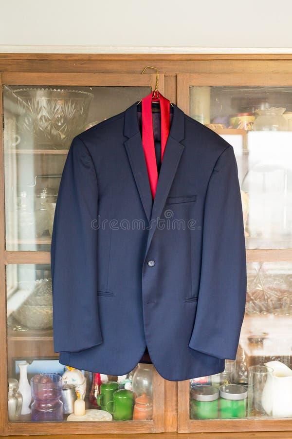Fornala kostiumu kurtki obwieszenie zdjęcie royalty free