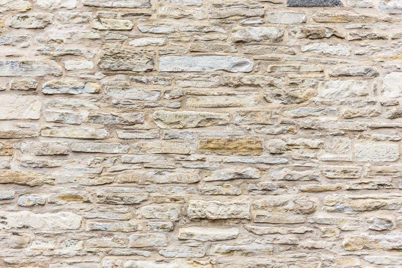 Forntida antik naturlig bakgrund för textur för stentegelstenvägg royaltyfria bilder