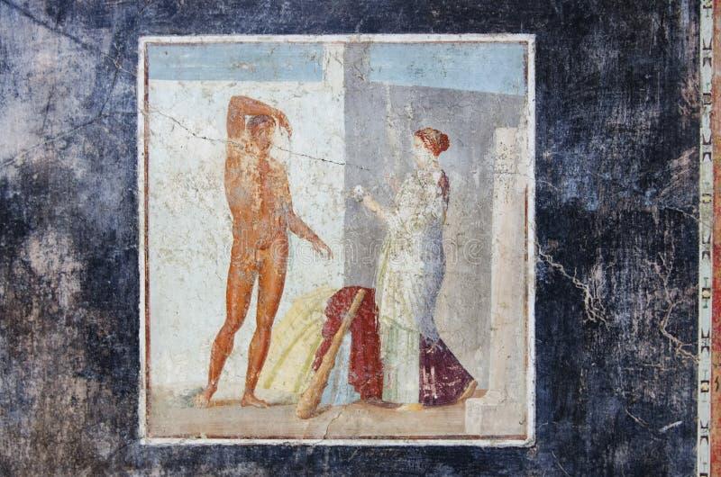 Forntida freskomålning av Hercules i det Pompeii huset fotografering för bildbyråer