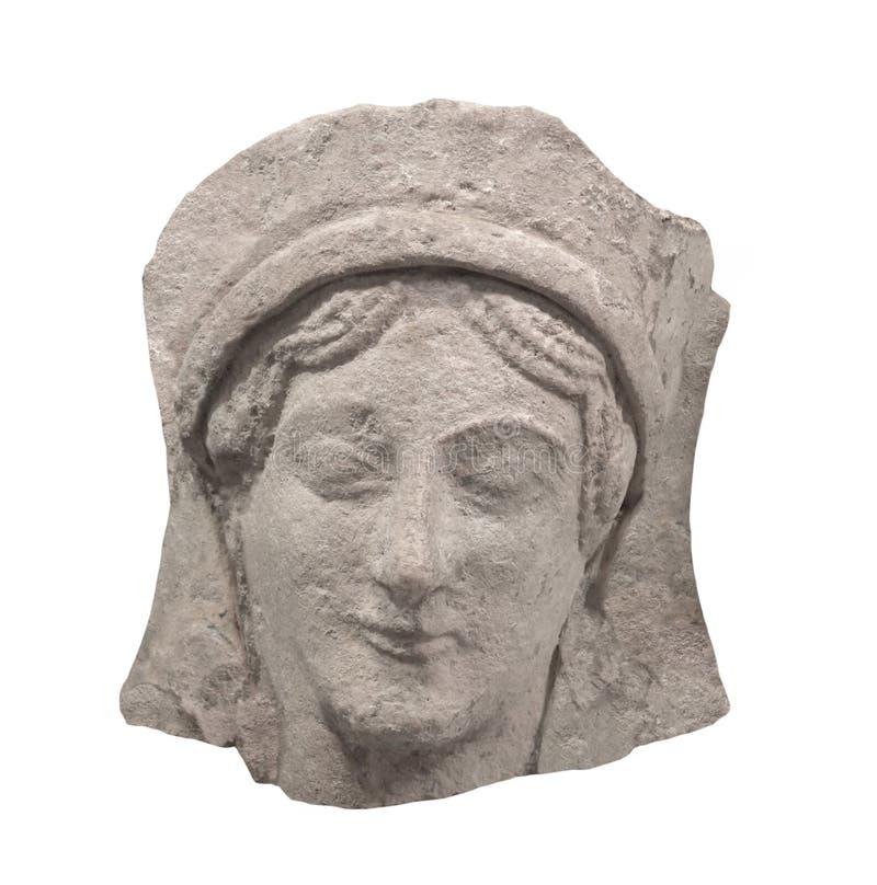 Forntida grekisk bas-lättnad vänder mot isolerat royaltyfri foto