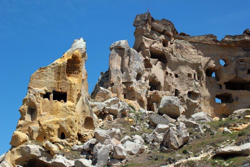 Forntida grottastad av Cavusin i Cappadocia, Turkiet royaltyfri foto