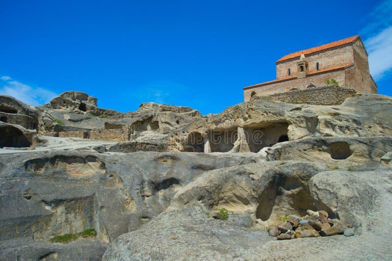Forntida grottastad för kyrka av Uplistsikhe, Georgia royaltyfri foto