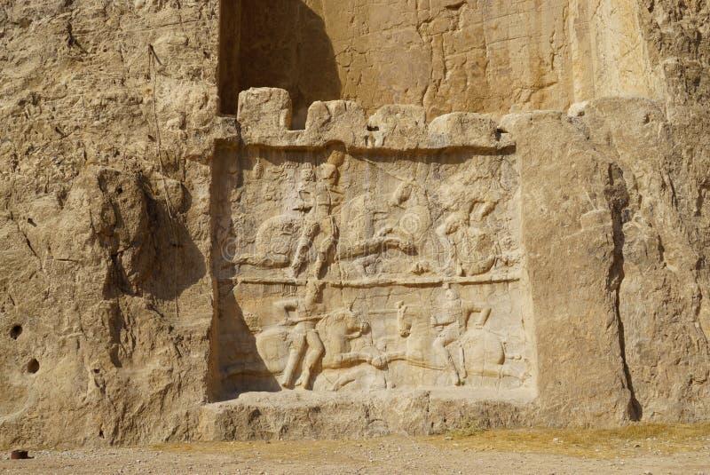 Forntida lättnad av nekropolen Naqsh-e Rustam i Iran arkivfoto