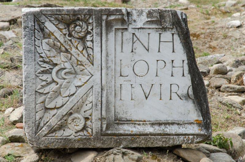 Forntida latinsk skrift royaltyfri bild