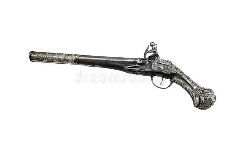 Forntida pistol eller musköt på en vit bakgrund fotografering för bildbyråer