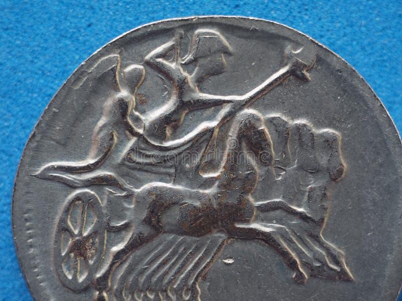 forntida roman mynt med hästar och bigaen (triumfvagn royaltyfria foton