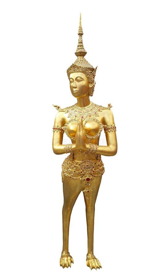 Forntida staty av den guld- thailändska fen i en legend som isoleras på vit bakgrund med den snabba banan, thailändsk konstskulpt royaltyfria bilder