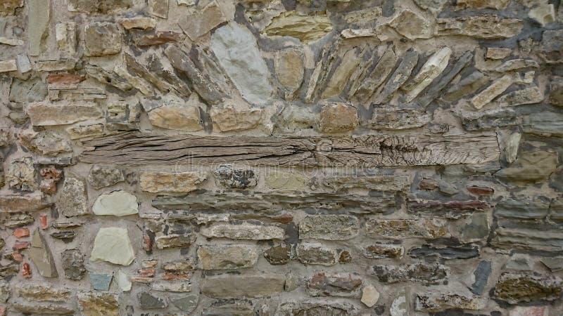Forntida stenvägg med Beem royaltyfri foto