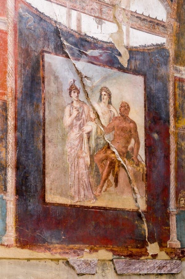 Forntida väggmålning av Hercules, Minerva och Juno i Herculaneum, Italien arkivbilder