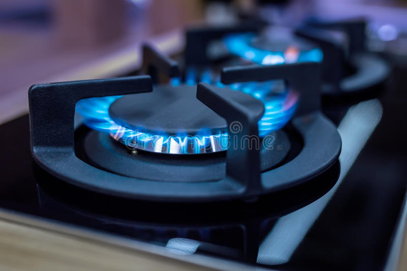 fornuis Kokfornuis Modern keukenfornuis met het blauwe vlammen branden stock foto's